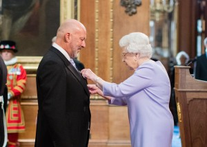 Mark Moran receiving his MBE